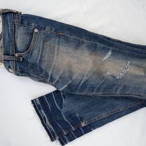Ripped denims with light fray bottom